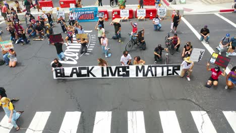 Aerial-Over-Crowds-Large-Black-Lives-Matter-Blm-Protest-March-Kneeling-On-The-Street-Ventura-California