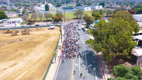 High-Vista-Aérea-Over-Large-Crowds-In-Street-Black-Lives-Matter-Blm-Protest-March-Marching-Through-Ventura-California-1
