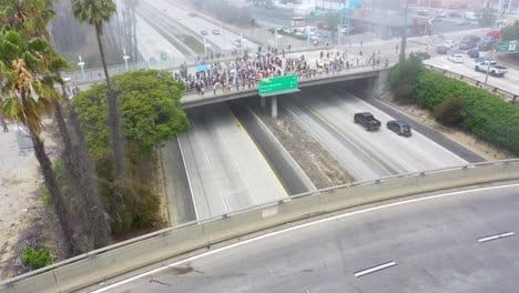 High-Aerial-Over-Large-Crowds-On-Freeway-Overpass-Black-Lives-Matter-Blm-Protest-In-Ventura-California