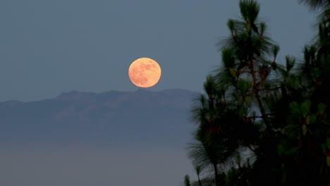 A-Full-Moon-Rises-Above-Los-Angeles-Suburbs-Malibu-Hills-Southern-California-Moonrise