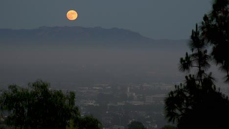 A-Full-Moon-Rises-Above-Los-Angeles-Ventura-Suburbs-Malibu-Hills-Southern-California-Moonrise