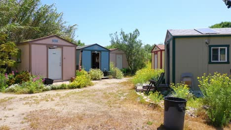 Aerial-Of-Storage-Sheds-Converted-Into-Homeless-Encampments-In-The-River-Bed-Area-Of-Ventura-Oxnard-California