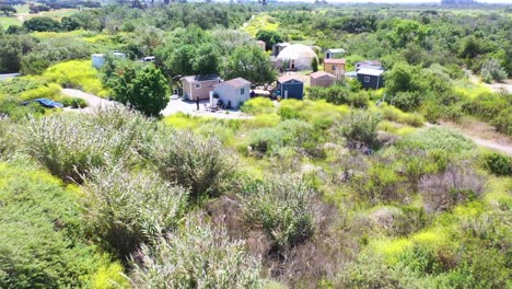 Aerial-Of-Storage-Sheds-Converted-Into-Homeless-Encampments-In-The-River-Bed-Area-Of-Ventura-Oxnard-California-1