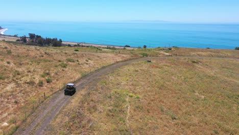 Aerial-Ranchers-Drive-Atv-Along-Ridgetop-Of-A-Ranch-On-The-Gaviota-Coast-Near-Santa-Barbara-California