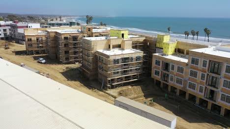 Rising-Aerial-Of-Condos-And-Development-Construction-Along-The-Pacific-Coast-Near-Ventura-California