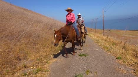 A-Retired-Couple-Enjoys-Retirement-Riding-Horses-Horseback-On-A-Ranch-In-Santa-Barbara-California-1