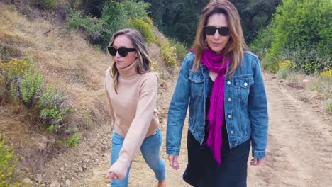 A-Mother-And-Daughter-Walk-In-Slow-Motion-On-A-Trail-In-The-Mountains-Of-Santa-Barbara-California