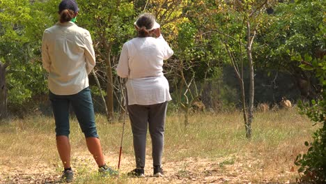 A-Blind-Woman-Walks-With-Stands-Near-Deer-Grazing-With-A-Guide-Helping-Her-Explore-The-Wilderness