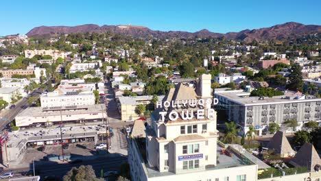 Antena-Sobre-El-Hollywood-Tower-Hotel-Revela-El-Observatorio-Del-Parque-Griffith-Y-El-Letrero-De-Hollywood-Distante-1