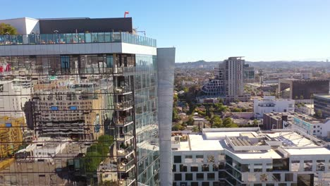Aerial-Of-Reflective-Mirrored-High-Rise-Apartment-Building-In-Hollywood-Los-Angeles-California