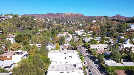 High-Angle-Establishing-Hollywood-Hills-Above-Beachwood-Drive-In-Hollywood-With-Cars-Driving-Up-Towards-Hollywood-Sign