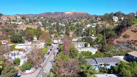 Aerial-Above-Beachwood-Drive-In-Hollywood-With-Cars-Driving-Up-Towards-Hollywood-Sign-2