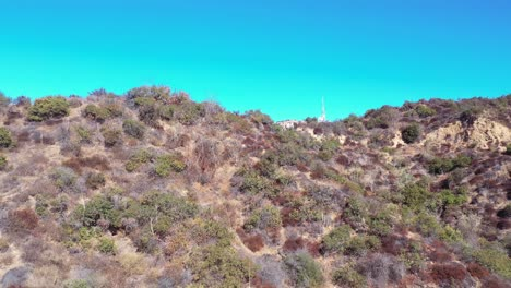 Rising-Aerial-Over-The-Hollywood-Hills-Reveals-Hikers-Near-The-Hollywood-Sign-And-Hillside-Mansions-Neighborhoods-And-Homes