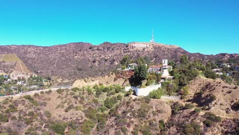 Rising-Aerial-Over-The-Hollywood-Hills-The-Hollywood-Sign-And-Hillside-Mansions-Neighborhoods-And-Homes