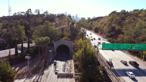 Aerial-Freeway-Cars-Travel-Along-The-110-Freeway-In-Los-Angeles-Through-Tunnels-And-Towards-Downtown-Skyline-4