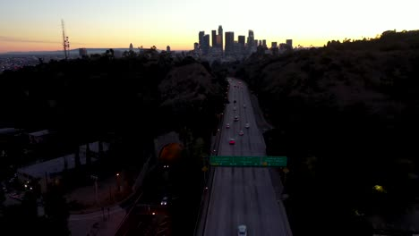 Night-Or-Dusk-Aerial-Over-The-110-Pasadena-Harbor-Freeway-And-Traffic-Leading-Into-Downtown-Los-Angeles-2
