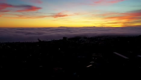 Night-Or-Dusk-Aerial-Over-Fog-Rolling-Into-Ventura-California-City-Near-Los-Angeles