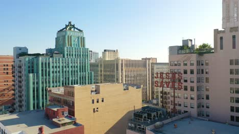 Aerial-Of-Older-Apartment-Buildings-And-Gentrified-Historic-Buildings-In-Downtown-Los-Angeles-Includes-Jesus-Saves-Sign-And-Eastern-Building