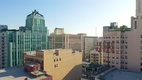 Aerial-Of-Older-Apartment-Buildings-And-Gentrified-Historic-Buildings-In-Downtown-Los-Angeles-Includes-Jesus-Saves-Sign-And-Eastern-Building-1