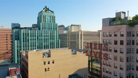 Aerial-Of-Older-Apartment-Buildings-And-Gentrified-Historic-Buildings-In-Downtown-Los-Angeles-Includes-Jesus-Saves-Sign-And-Eastern-Building-2