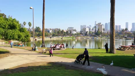 Aerial-Of-People-Having-Picnic-And-Walking-At-Macarthur-Park-Lake-Near-Downtown-Los-Angeles-California-Wishire-District