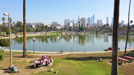 Aerial-Of-People-Having-Picnic-And-Walking-At-Macarthur-Park-Lake-Near-Downtown-Los-Angeles-California-Wishire-District-1