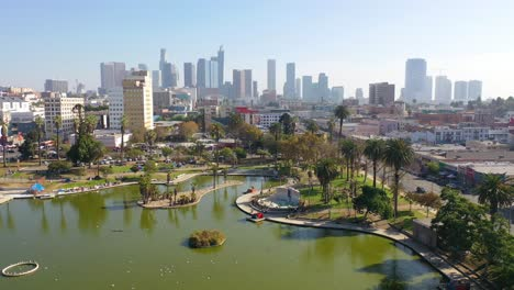 Aerial-Of-Macarthur-Park-Lake-Near-Downtown-Los-Angeles-California-Wishire-District-With-City-Skyline-Background-1