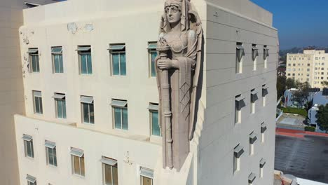 Aerial-Of-The-Macarthur-Building-In-Los-Angeles-With-Elaborate-Warrior-And-Angel-Friezes-And-Sculpted-Figures-Overlooking-The-City-2