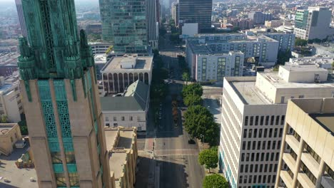 Aerial-Of-Wilshire-Blvd-In-Los-Angeles-Passing-The-Bullocks-Wilshire-Art-Deco-Building