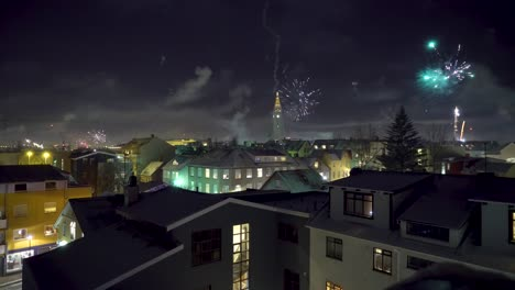 Fireworks-go-off-on-New-Year-s-Eve-in-Reykjavik-Iceland-with-the-Hallgrimskirkja-church-in-sight