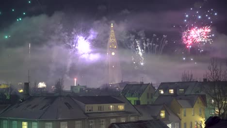 Fireworks-go-off-on-New-Year-s-Eve-in-Reykjavik-Iceland-with-the-Hallgrimskirkja-church-in-sight-2