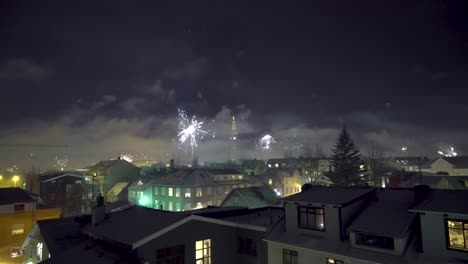 Fireworks-go-off-on-New-Year-s-Eve-in-Reykjavik-Iceland-with-the-Hallgrimskirkja-church-in-sight-3