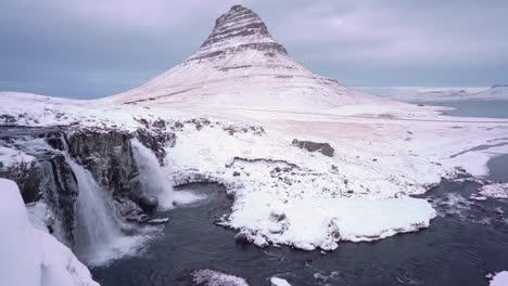 Waterfalls-flow-near-Kirkjufell-Mountain-during-wintertime-on-the-Snaefellsne-Peninsula-of-Iceland