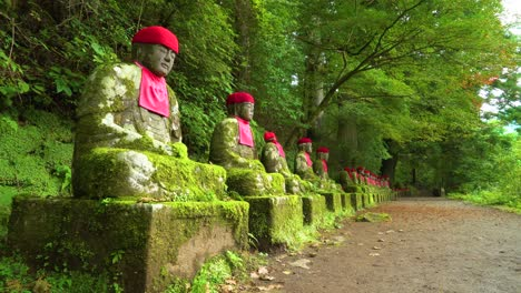 The-NarabiJizo-statues-are-seen-in-a-forested-area-of-Nikko-Japan-1