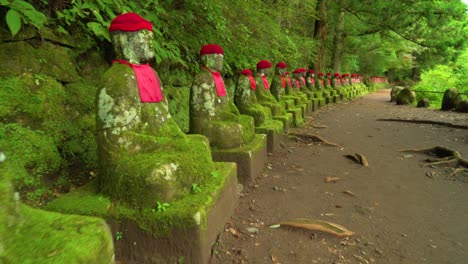The-NarabiJizo-statues-are-seen-in-a-forested-area-of-Nikko-Japan-4