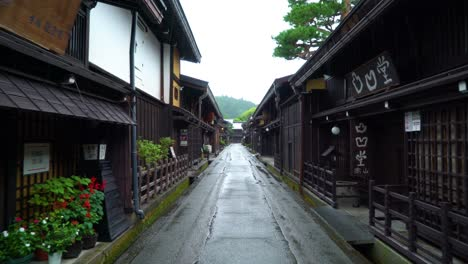 A-vehiclemounted-camera-captures-footage-as-it-drives-down-a-rainy-Sanmanchi-Suji-street-in-Takayama-Japan