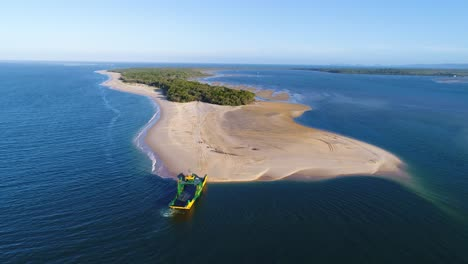 A-Van-Drives-Off-A-Large-Vessel-And-Onto-Rainbow-Beach-In-Queensland-Australia