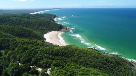 An-Aerial-View-Shows-Waves-Lapping-At-Whites-Beach-In-Byron-Bay-Australia