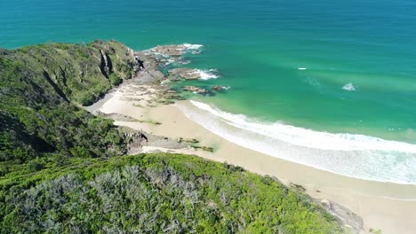 An-Aerial-View-Shows-Waves-Lapping-At-Whites-Beach-In-Byron-Bay-Australia-1