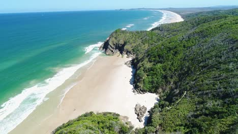 An-Aerial-View-Shows-Waves-Lapping-At-Whites-Beach-In-Byron-Bay-Australia-2