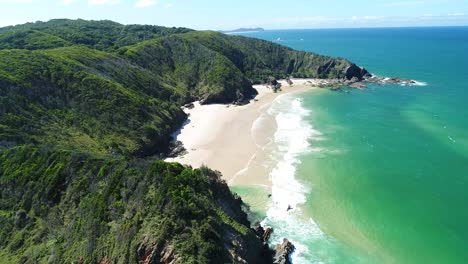 An-Aerial-View-Shows-Tourists-Enjoying-The-Waves-At-Whites-Beach-In-Byron-S-Bay-Australia