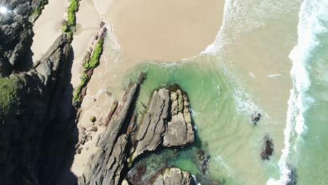An-Aerial-View-Shows-Swimmers-Enjoying-Whites-Beach-In-Byron-S-Bay-Australia