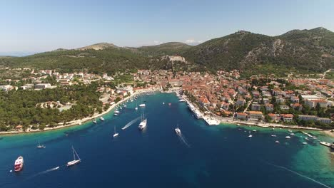 An-Aerial-View-Shows-Boats-Approaching-The-Port-Of-Hvar-Croatia