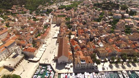 An-Aerial-View-Shows-Boats-Docked-In-The-Port-Town-Of-Hvar-Croatia