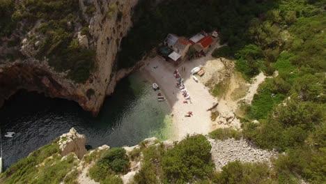 A-Bird-Seyeview-Shows-Tourists-Enjoying-Stiniva-Beach-In-Vis-Croatia