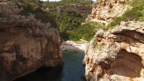 An-Aerial-View-Shows-Tourists-Enjoying-Stiniva-Beach-In-Vis-Croatia