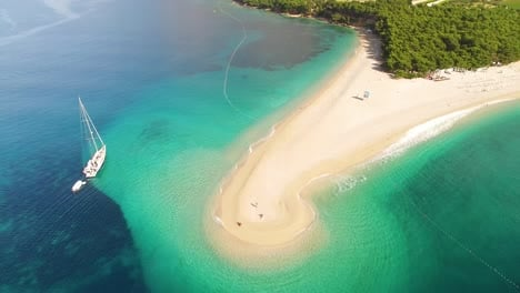 An-Aerial-View-Shows-Boats-Anchored-By-Zlatni-Rat-Beach-On-Brac-Island-Croatia