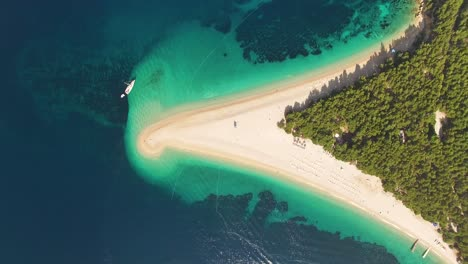 A-Bird-Seyeview-Shows-Boats-Anchored-By-Zlatni-Rat-Beach-On-Brac-Island-Croatia
