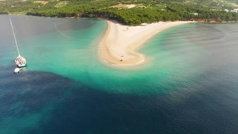 An-Aerial-View-Shows-Tourists-Enjoying-Zlatni-Rat-Beach-On-Brac-Island-Croatia