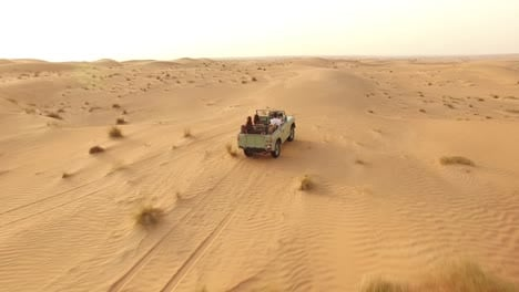 Tourists-Drive-Through-A-Desert-In-Dubai-United-Arab-Emirates